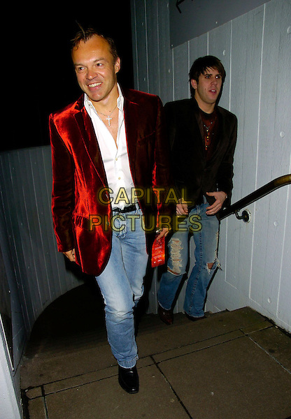 "GRAHAM NORTON & GUEST.At the ""Dreamgirls"" Film Premiere After Party, Hayward Gallery, London, England, January 21st 2007..full length red velvet jacket jeans steps.CAP/CAN.©Can Nguyen/Capital Pictures"