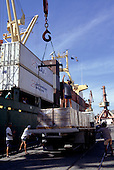 Paranagua Port, Parana State, Brazil. Crane loading pallettes with containers stacked.