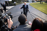 US President Donald J. Trump delivers remarks as he walks to board Marine One on the South Lawn of the White House  in Washington DC, USA, 02 December 2017. President Trump commented on the tax reform package passed by the Senate and on the guilty plea by former National Security Advisor Michael Flynn. Photo Credit: Shawn Thew/CNP/AdMedia