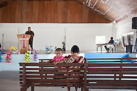 A mother and child attend a Sunday church service on Majuro Atoll.