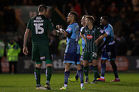 Sonny Bradley of Plymouth Argyle shakes hands with Paris Cowan-Hall of Wycombe Wanderers at full time of the Sky Bet League 2 match between Plymouth Argyle and Wycombe Wanderers at Home Park, Plymouth, England on 26 December 2016. Photo by Mark  Hawkins / PRiME Media Images.