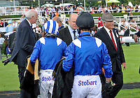 03.08.2013 Goodwood, England.  Jockeys returning to the weigh in during day five of the  Glorious Goodwood Festival.