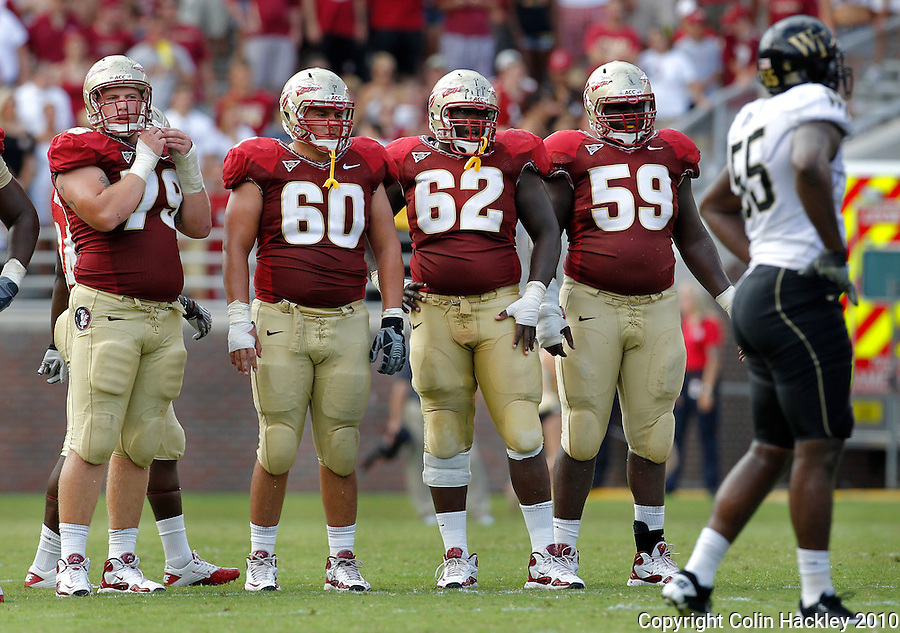 TALLAHASSEE, FL 9/25/10-FSU-WF FB10 CH-Florida State's offensive linemen David Spurlock, left, Ryan McMahon, Rodney Hudson and Henry Orelus get ready for another play against Wake Forest during first half action Saturday at Doak Campbell Stadium in Tallahassee. .COLIN HACKLEY PHOTO