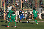 Palestinian soccer team of Rafah services club compete against team of Rafah youth in Rafah in souther Gaza Strip on Oct. 25, 2013. The match ended in a goalless draw. Photo by Eyad Al Baba