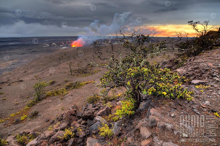 At sunset, the lava lake glows at Halemaʻumaʻu Crater, Hawai'i Volcanoes National Park, Island of Hawai'i.