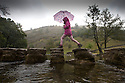 25/08/14 <br /> <br /> Sheltering under her umbrella, Suzanne Roberts, 6, crosses the stepping stones at Dovedale in the Derbyshire Peak district as rain sweeps across the country for Bank Holiday Monday. Yesterday hundreds of day-trippers visited the same spot (sees before photos).<br /> <br /> All Rights Reserved: F Stop Press Ltd. +44(0)1335 300098   www.fstoppress.com.