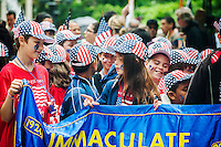 Students from the Immaculate Conception School in Astoria, Queens march in the annual Flag Day Parade on Friday, June 14, 2013, starting at New York City Hall Park. Flag Day, was created by proclamation by President Woodrow Wilson on June 14, 1916 as a holiday honoring America's flag but it was not until 1949 when it became National Flag Day.  The holiday honors the 1777 Flag Resolution where the stars and stripes were officially adopted as the flag of the United States. (© Richard B. Levine)