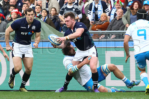 27.02.2016. Stadio Olimpico, Rome, Italy. RBS Six Nations Championships. Italy versus Scotland. HOGG STUART passes off as he encounteres the cover from Gori of Italy