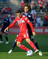 New England defender Kevin Alston (30) pressures Chicago midfielder Marco Pappa (16).  The Chicago Fire defeated the New England Revolution 3-2 at Toyota Park in Bridgeview, IL on Sept. 25, 2011.