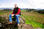 Clay Shannon, a longtime grower in High Valley, sits on lava rocks in the Vigilance Vineyard of the Red Hills appellation, in Clearlake Oaks, Ca., on Saturday, Jan. 30, 2010. Shannon, who moved to the area in 1995, owns the Shannon Ridge label and 1250 acres of vineyard.