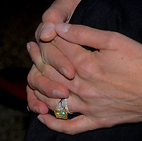 Washington DC., USA, December 15, 2006<br /> Sylvester Stallone holds his wife Jennifer Flavin's hand (with the large yellow diamond ring) at event where he  donates the boxing memorabilia from the &quot;Rocky&quot; movies to the Smithsonian museum of American History. For the exhibit ''Treasures of the Smithsonian&quot; Credit: Mark Reinstein/MediaPunch
