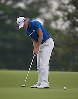 Danny Willett (ENG) sinks a birdie on the 7th during the Final Round of the 2014 Maybank Malaysian Open at the Kuala Lumpur Golf & Country Club, Kuala Lumpur, Malaysia. Picture:  David Lloyd / www.golffile.ie