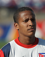Cuban midfielder Alberto Gomez (20). In CONCACAF Gold Cup Group Stage, the national team of Cuba (white) defeated national team of Belize (red), 4-0, at Rentschler Field, East Hartford, CT on July 16, 2013.