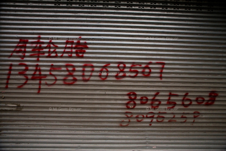 Laborers numbers are painted on a wall in Mianyang, Sichuan, China.