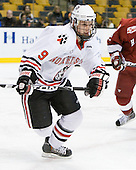 Garrett Vermeersch (Northeastern - 9) - The Northeastern University Huskies defeated the Harvard University Crimson 4-0 in their Beanpot opener on Monday, February 7, 2011, at TD Garden in Boston, Massachusetts.