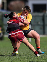 Tay-a Antonievic of Papakura fends the tackle of (???? Not listed on team sheet)!! Premier Women's Rugby League, Papakura Sisters v Manurewa Wahine, Prince Edward Park, Auckland, Sunday 13th August 2017. Photo: Simon Watts / www.phototek.nz