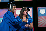 Sophie Cervantez, a public safety officer, right, presents her daughter her degree Saturday, June 10, 2017, during the DePaul University College of Education commencement ceremony at the Rosemont Theatre in Rosemont, IL. (DePaul University/Jeff Carrion)