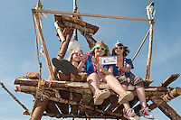 Some scouts from finland sit on a wood tower and have a lot of fun during the culture festival.
