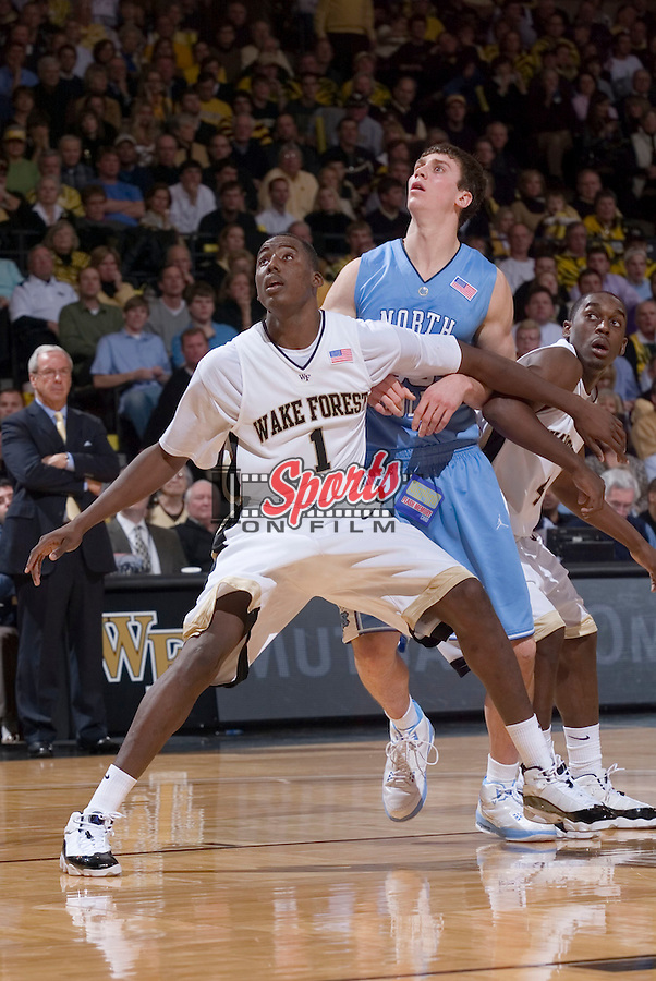 WINSTON-SALEM, NC - JANUARY 11:  Al Farouq Aminu #1 of the Wake Forest demon Deacons boxes out Tyler Hansbrough #50 of the North Carolina Tar Heels during second half action at the LJVM Coliseum January 11, 2009 in Winston-Salem, North Carolina.  The Demon Deacons defeated the Tar Heels 92-89.  (Photo by Brian Westerholt / Sports On Film)