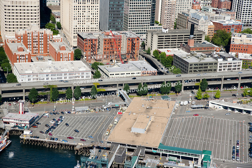 An aerial view of the ferry terminal and middle portion of the Alaskan Way viaduct / Highway 99 in downtown Seattle.
