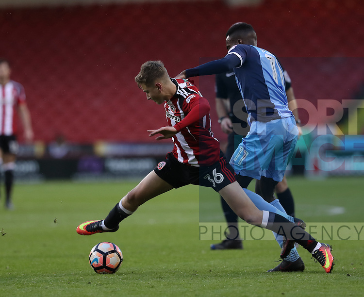 David Brooks of Sheffield United challenged by Gavin Massey of Leyton Orient during the Emirates FA Cup Round One match at Bramall Lane Stadium, Sheffield. Picture date: November 6th, 2016. Pic Simon Bellis/Sportimage