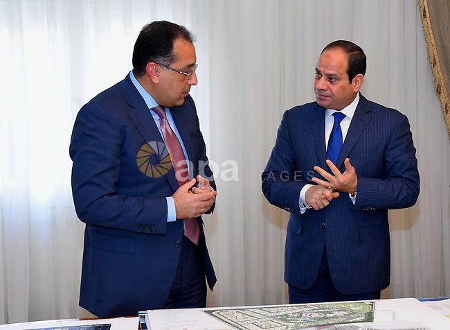 Egyptian President Abdel Fattah al-Sisi meets with Mustafa Madbouli, Housing Minister in Cairo, Egypt on January 3, 2017. Photo by Egyptian President Office
