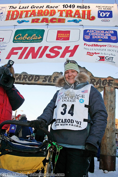 Thursday  March 15, 2007   ---- Nome, Alaska.  Silivia Willis poses at her sled at the finish line in Nome after finishing the Iditarod in 27th place.