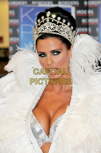 """JORDAN - KATIE PRICE.Launches her new book """"Angel Uncovered"""" at Borders book store, London, England..July 17th, 2008.headshot portrait silver sequins sequined feathers feathered collar jewel encrusted crown plunging neckline cleavage bra mouth open .CAP/PL.©Phil Loftus/Capital Pictures."""