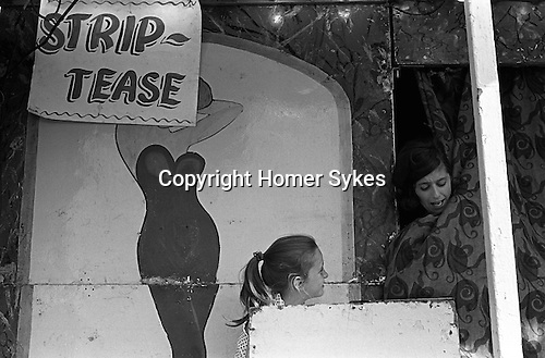 Strip tease booth at the Derby Horse Race Epsom Downs. Surrey England 1969.<br />