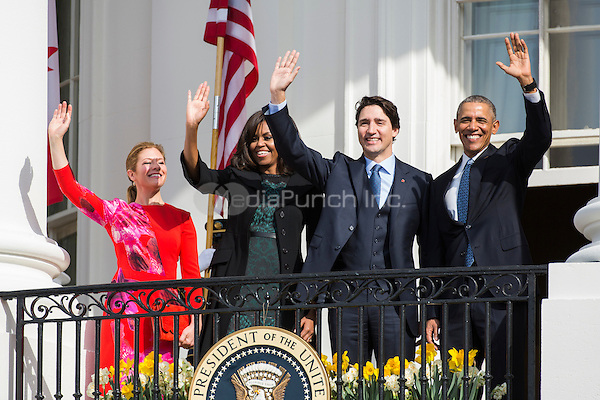 U.S. President Barack Obama (R), Prime Minister of Canada Justin Trudeau (C-R), U.S. First Lady Michelle Obama (C-L), and spouse of the Prime Minister of Canada Sophie Gr&Egrave;goire Trudeau (L), wave from the balcony of the White House, in Washington, DC, USA, 10 March 2016. This is the first official visit of Prime Minister of Canada Justin Trudeau to the White House. <br /> Credit: Jim LoScalzo / Pool via CNP/MediaPunch