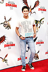 US actor Booboo Stewart shows his love for animals as he arrives at the USA/LA premiere of Dreamworks Animation's 'How To Train Your Dragon' held at the Gibson Amphitheatre at Universal City in Los Angeles on March 21, 2010. The movie is set in the mythical world of burly Vikings and wild dragons and will be released in the US March 26, 2010..Photo by Nina Prommer/Milestone Photo