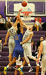 SIOUX FALLS, SD - NOVEMBER 24: Bryan Kielpinski #52 and Cutler Finneman #50 from the University of Sioux Falls double team a block on Ian Barse #20 from Dakota State University in the first half of their game Monday night at the Stewart Center.  (Photo by Dave Eggen/Inertia)