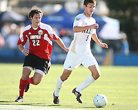 Perry Kitchen #5 of the University of Akron moves the ball away from Dylan Mares #22 of the University of Louisville during the 2010 College Cup final at Harder Stadium, on December 12 2010, in Santa Barbara, California.Akron champions, 1-0.