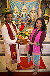 © Joel Goodman . 18 May 2013 . Gita Bhavan Hindu Temple , Withington Road , Whalley Range , Manchester . L-R Acharya (instructor) Shyam Sunder Sharma and Dr Poonam Kakkar hold the pot . Commemorative service to celebrate the handover of the Green Kumbh Yatra (green journey pot or environmental pilgrimage) at the Gita Bhavan Hindu Temple in Manchester . The pot has travelled to the Maha Kumbh Mela , Kenya , Nepal and the Western Wall in Jerusalem along the way . At every place of rest an environmental action must be taken to reflect the pot's environmental significance . It's due to travel to Leicester and feature in an outdoor procession in London on 24th May 2013 . Photo credit : Joel Goodman