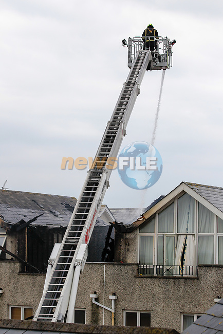 Two units for Drogheda Fire service backed up by two units from Meath Fire service and one Unit of Dublin Fire brigade attended the scene of a multi apartment fire in the Anchorage Bettystown Co Meath. The bustling sea side village was brought to a halt after the fire that gutted the second floor apartments quickly spread. There was no report of any injuries as the fire service felt with the blaze.<br /> Picture Newsfile | Fran Caffrey