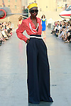 Grace walks runway in a Douglas Hannant Resort 2012 outfit, on the USS Intrepid, June 7, 2011.