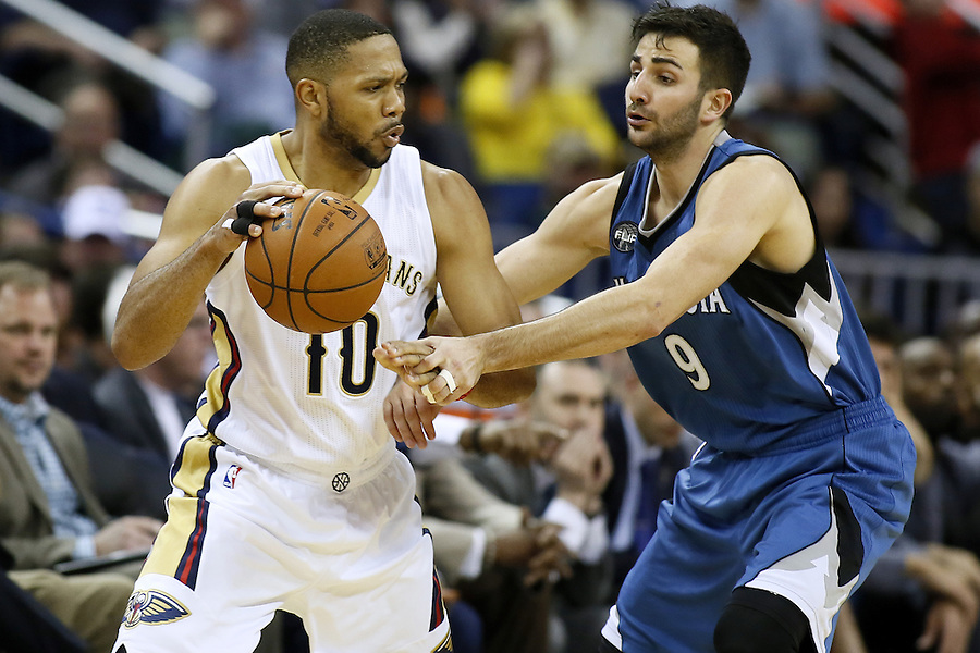 New Orleans Pelicans guard Eric Gordon (10) drives against Minnesota Timberwolves guard Ricky Rubio (9) during the second half of an NBA basketball game Saturday, Feb. 27, 2016, in New Orleans. The Timberwolves won 112-110. (AP Photo/Jonathan Bachman)