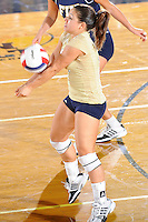 27 September 2008:  FIU setter Natalia Valentin (9) keeps the ball in play in the second set of the FIU 3-0 (25-13, 25-23, 25-18) victory in straight sets over Troy at Golden Panther Arena in Miami, Florida.