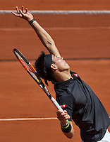 Paris, France, 25 June, 2016, Tennis, Roland Garros,  Kei Nishikori (JPN) serving<br /> Photo: Henk Koster/tennisimages.com