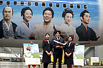 "April 21, 2018, Tokyo, Japan - Japanese actor Ryohei Suzuki (C) holding a model plane poses with Japan Airlines (JAL) cabin attendants at a JAL hanger of Tokyo's Haneda airport on Saturday, April 21, 2018. JAL unveiled a wrapped jetliner with casts' faces of a TV drama ""Segodon"" .   (Photo by Yoshio Tsunoda/AFLO) LWX -ytd-"