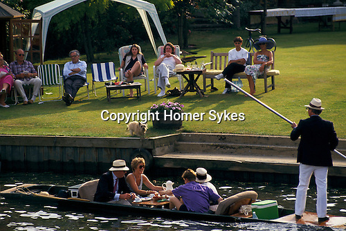 'HENLEY ROYAL REGATTA', A LAZY AFTERNOON ON THE RIVER ENJOYING THE ROWING COMPETITION OR JUST MESSING AROUND.