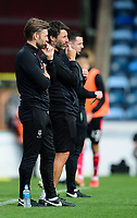 Lincoln City's assistant manager Nicky Cowley, left, and Lincoln City manager Danny Cowley in their technical area<br /> <br /> Photographer Andrew Vaughan/CameraSport<br /> <br /> The EFL Sky Bet League One - Wycombe Wanderers v Lincoln City - Saturday 7th September 2019 - Adams Park - Wycombe<br /> <br /> World Copyright © 2019 CameraSport. All rights reserved. 43 Linden Ave. Countesthorpe. Leicester. England. LE8 5PG - Tel: +44 (0) 116 277 4147 - admin@camerasport.com - www.camerasport.com