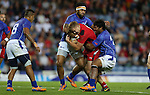 Glasgow 2014 Commonwealth Games<br /> Afa Alono and Levi Asifaamatala combine to stop James Davies.<br /> Wales v Samoa<br /> Ibrox Stadium<br /> <br /> 26.07.14<br /> &copy;Steve Pope-SPORTINGWALES