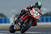 Eugene Laverty (IRL) riding the Aprilia RSV4 1000 Factory (58) of the Aprilia Racing Team exits turn 6 during a qualifying session on day one of round one of the 2013 FIM World Superbike Championship at Phillip Island, Australia.