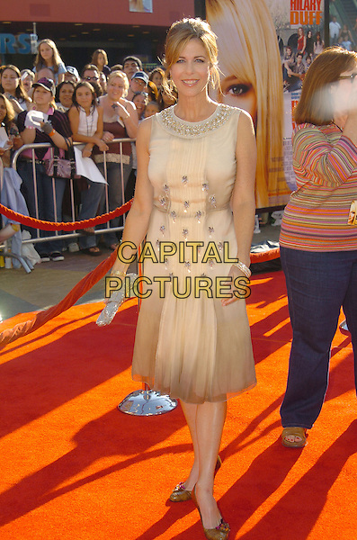 RITA WILSON.'Raise Your Voice' Los Angeles Premiere held at Lowes Universal City 18 Theatre. .Photo: V. Summers/AdMedia.October 3rd, 2004.full length, sleeveless cream beige dress.www.capitalpictures.com.sales@capitalpictures.com.© Capital Pictures.