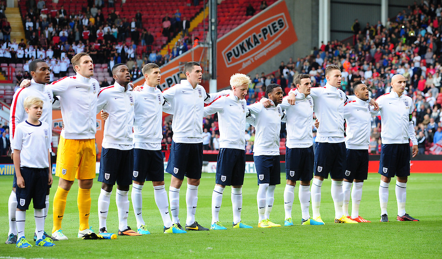 England players sing the national anthem before kick off<br /> <br /> (Photo by Chris Vaughan/CameraSport)<br /> <br /> Football - International U21 Friendly - England U21 v Scotland U21 - Tuesday 13th August 2013 - Bramall Lane - Sheffield<br /> <br /> &copy; CameraSport - 43 Linden Ave. Countesthorpe. Leicester. England. LE8 5PG - Tel: +44 (0) 116 277 4147 - admin@camerasport.com - www.camerasport.com