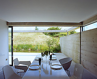 Kitchen and terrace seem to flow into one another creating an interchangeable 'inside-outside' space
