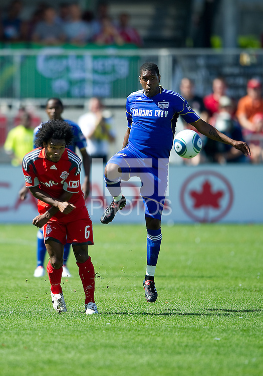 05 June 2010: Kansas City Wizards midfielder Craig Rocastle #4 battles with Toronto FC midfielder Julian de Guzman #6 during a game between the Kansas City Wizards and Toronto FC at BMO Field in Toronto..The game ended in a 0-0 draw.