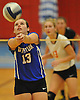 Mattituck No. 13 Carly Doorhy makes a set during the Suffolk County varsity girls' volleyball Class C final against Babylon at Suffolk Community College Grant Campus on Monday, November 9, 2015. Mattituck won 3-1.