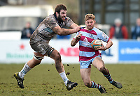 Caolan Ryan of Rotherham Titans is tackled by Will Carrick-Smith of Bedford Blues. Greene King IPA Championship match, between Rotherham Titans and Bedford Blues on January 17, 2018 at Clifton Lane in Rotherham, England. Photo by: Patrick Khachfe / Onside Images